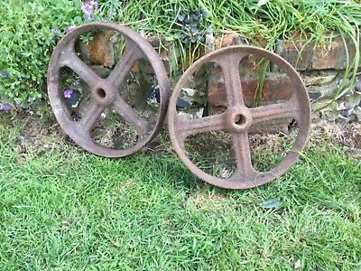 A set of two cast iron wheels