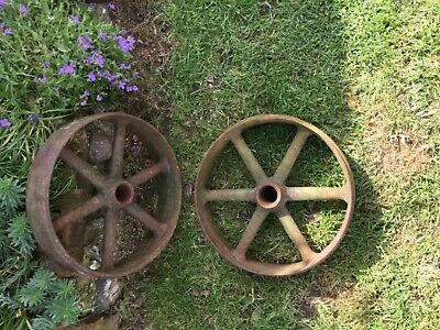 A pair of banded cast iron wheels