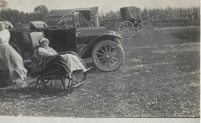 Antique photograph post card GIRL IN WHEEL CHAIR car BUGGY fashion POLIO MAYBE