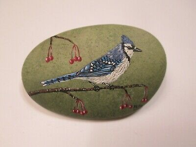 Bluejay hand painted on a rock by Ann Kelly