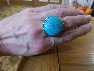 Brand new large silver plated Ring with a large turquoise stone Size K