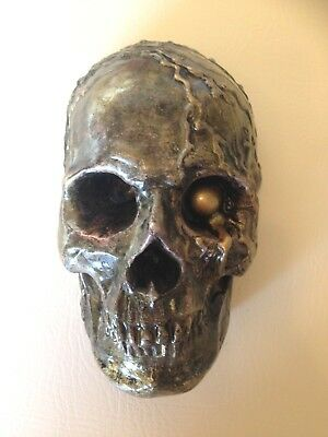 Hand cast style wall hanging skull painted gold and bronze colour effect