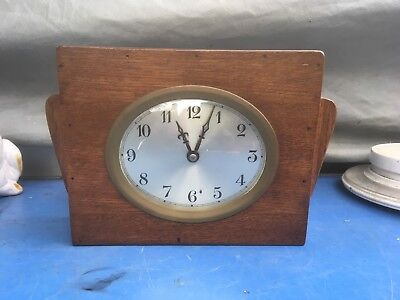 Vintage hand made clock.oval face clock