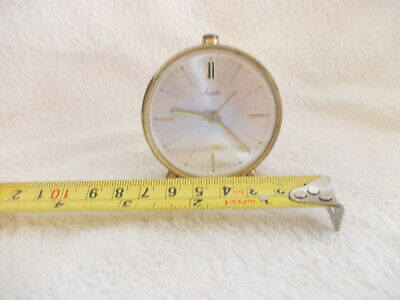 Small vintage Manthe travel alarm clock made in Germany, in working order.