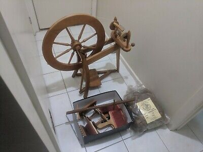 Spinning wheel with accessories and fleece