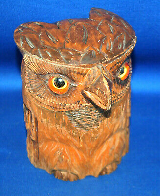 An antique owl tobacco jar, carved wooden Black Forest, with glass eyes