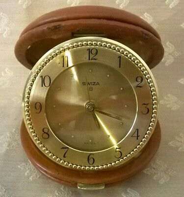 Vintage Swiza 8 travel alarm clock in tan leather case boxed with leaflet