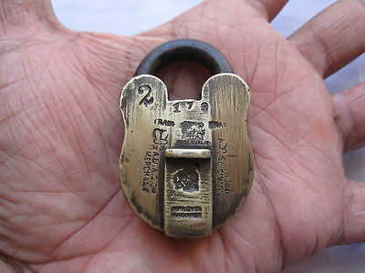 An old solid brass padlock or lock with key nice carving and unusual sized