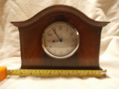 Small Oak mantel clock in working order no makers name.