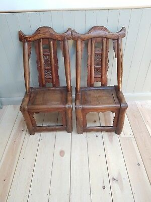 A pair of Chinese elm marriage chairs,