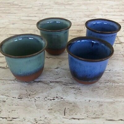 Set of Four Blue Green Glazed Raw Bottom Pottery Drinking Cups