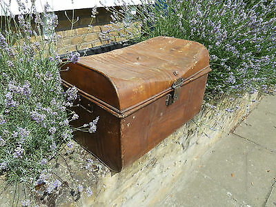 Large antique brown metal trunk or cabin chest