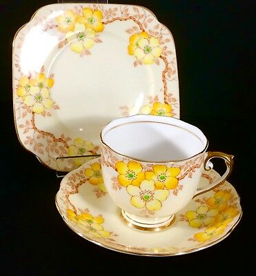 Roslyn English vintage china tea cup saucer set pretty yellow flowers