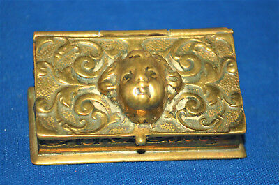 A superb antique Victorian desktop stamp box with repousse brass cherub face