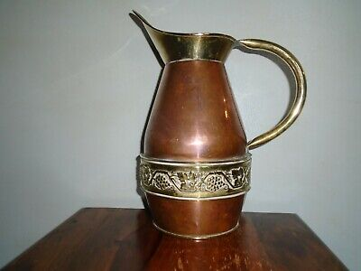 A Large Arts and Crafts Copper and Brass Wine Ewer.