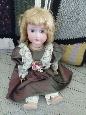 Beautiful german vintage doll, body section very heavy, dressed.