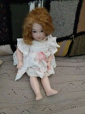 Very beautiful vintage doll,very heavy ful,y jointed bisque. Glass eyes. Etc.