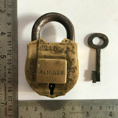 Brass padlock lock with key old, hidden key-hole and trick or puzzle to open.