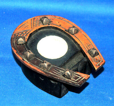 A super Victorian Mauchline type carved wooden horseshoe open topped inkwell