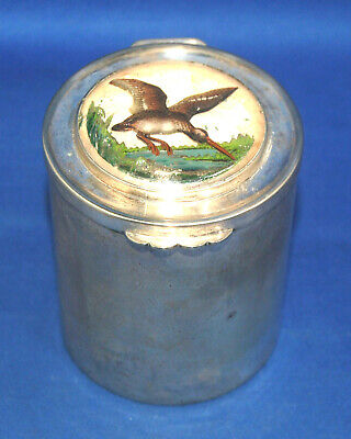An antique white metal cylinder shaped box, curlew bird Essex crystal style top
