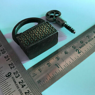 An old or antique Iron screw type miniature padlock lock with working key.