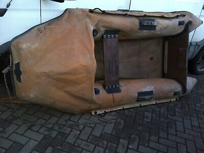 old well used grubby rib rubber hard flor rigid inflatable boat dinghy with oars