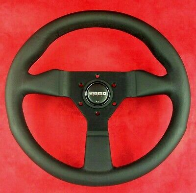 Genuine Momo Monte Carlo black stitch, black leather 320mm steering wheel.