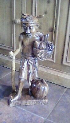 Wonderful Carved Wooden Asian Figure of an Old Fruit Seller from Cambodia.