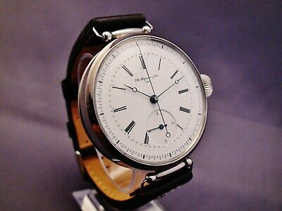 A. HUGUENIN & Sons, Locle. Two-train, jumping 1/4 seconds. Chronograph Watch.