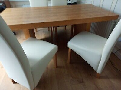 Morris of Glasgow solid wood table and four cream chairs