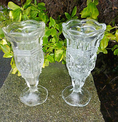 A pair of clear pressed glass vases