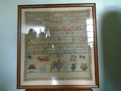 A Lovely Large Victorian Sampler Framed and Glazed by Dowie aged 9 .