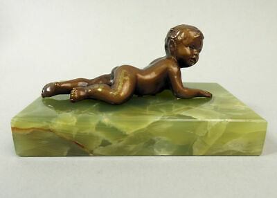 Antique Bronze Figure Of A Baby On An Onyx Base C.1900