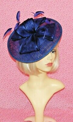 Elegant Royal Blue Sinamay Disc Fascinator with Bows & Feathers on Head Band.