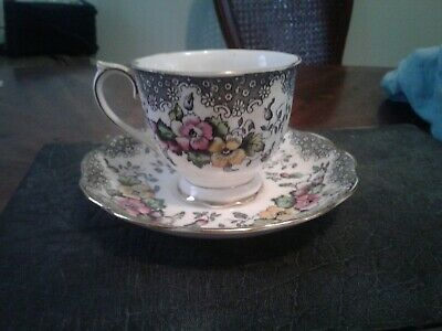 *Royal albert love lace teacup and saucer ,pattern in black.*