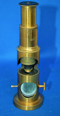 A characterful antique drum type brass microscope, single lens, no box