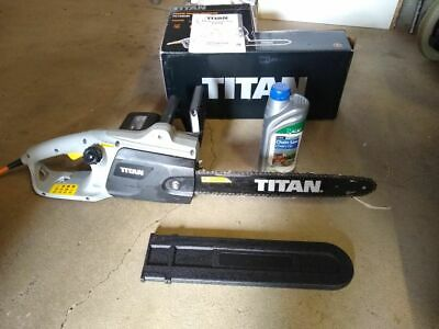 Titan TTL758CHN 2000w 40cm electric chainsaw 240v with oil, used for 30 mins