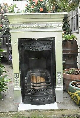 Small Antique Edwardian cast iron bedroom fireplace in the Art Nouveau style
