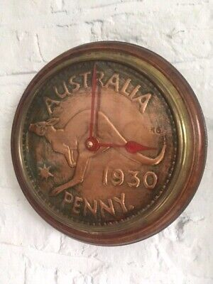Round wooden vintage wall clock with  copper coin dial