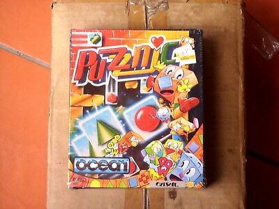 Brand new sealed Puzznic dual media for C64 from Ocean distributed by OziSoft