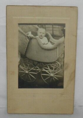 Antique Cabinet Card Photo BABY IN WICKER CARRIAGE W/ Unusual Expression c 1900