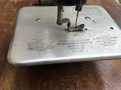 Antique Sewing Machine Willcox and Gibbs 1871 with treadle stand.