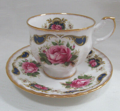 Queen Anne Tea Cup and Saucer set White Floral Footed Ribbed Gilded Pink Blue