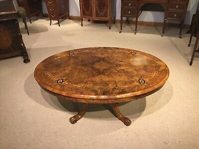 A burr walnut marquetry inlaid Victorian Period oval coffee table.