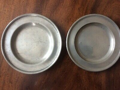 A MATCHED PAIR OF 18th CENTURY ENGLISH PEWTER PLATES.