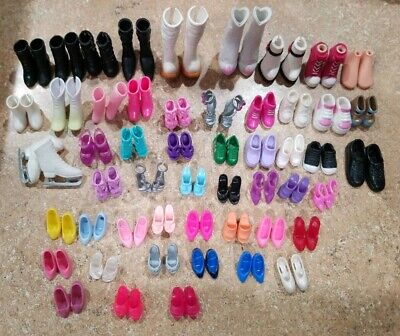 52 pairs of of Bratz, Barbie, Monster high,  Ect. Doll shoes/ feet.