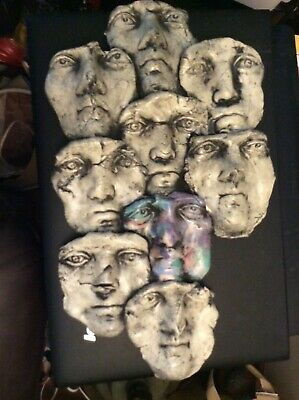 "Wall-Art Sculpture 9 Faces by Ritter 10"" by 17"""