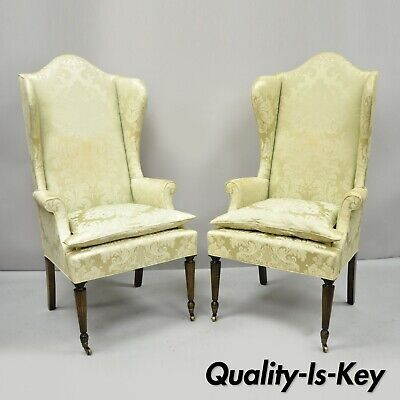 Vintage High Tall Back Sheraton Style Wing Chairs on Brass Rolling Casters