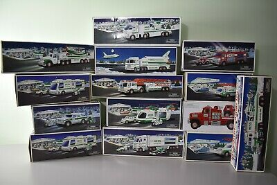 LOT OF 14 Hess Collectible Truck Lot of 14 Trucks - New in Original Box
