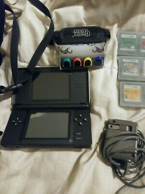 Nintendo DS lite with Guitar Hero attachment ,games charger and case,used